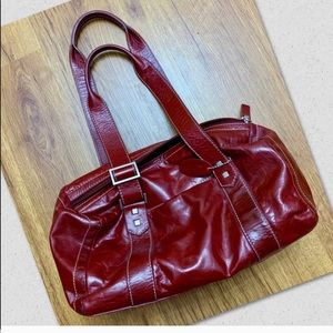 Rolf's genuine leather burgundy handbag